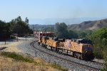 UP 5959 and a couple SD70M's lead an intermodal uphill.