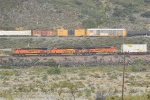 Three BNSF GEVOS's lead an intermodal past the UP train going up the Palmdale Cutoff