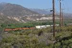 A BNSF intermodal glides downhill