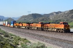 BNSF 7050 leads a stacker up the middle track at Cajon Junction