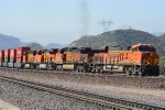 BNSF 7147 leads a stacker up the third track at Cajon Junction