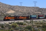 A westbound intermodal is about to drop downhill at Summit