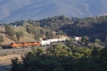 The BNSF train seen earlier stopped near the town of Tehachapi is seen on the move.