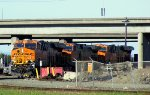 Triple BNSF GE engines heading under I-580