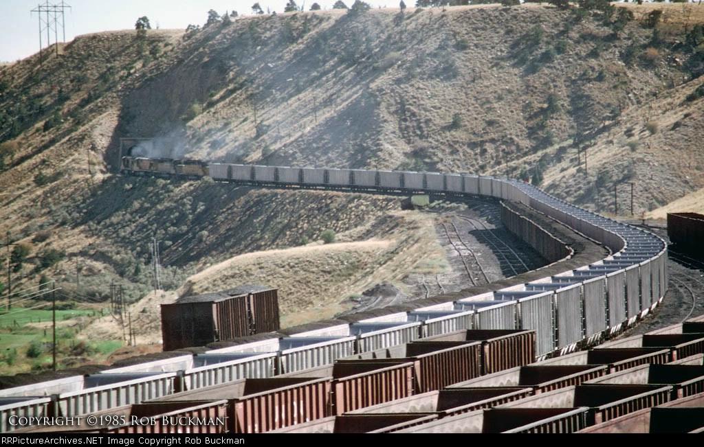 Quartet of UP units drag empty coal cars into Utah coal country on Utah Railroad