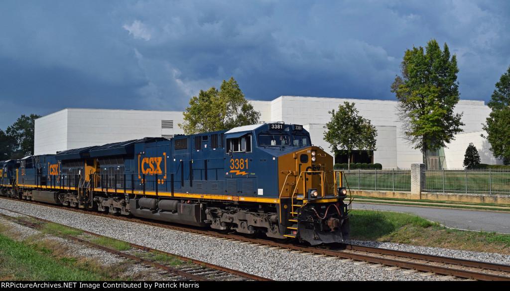CSX 3381 ET44AH leads CSX 3378 ET44AH CSX 4048 SD40-3 CSX 6248 GP38-2S rushing south ahead of a storm through Cartersville GA 4-42PM 09-22-2017