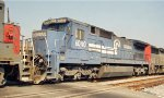 CR 6040 C40-8 in a light power moving backing south into the NS Oliver Yard in New Orleans LA under late morning sun in 04-2000