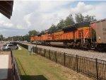 BNSF 9336 passs the platform as the 2ed unit on a NS coal train
