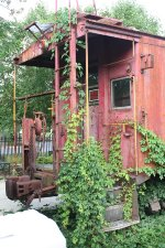Old caboose NW 557588 behind the restaurant