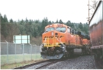 BNSF 7630 stays in the hole at PB grains among the pine trees at Kaalama, Wa