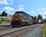 A westbound manifest passes the autorack waiting for a new crew