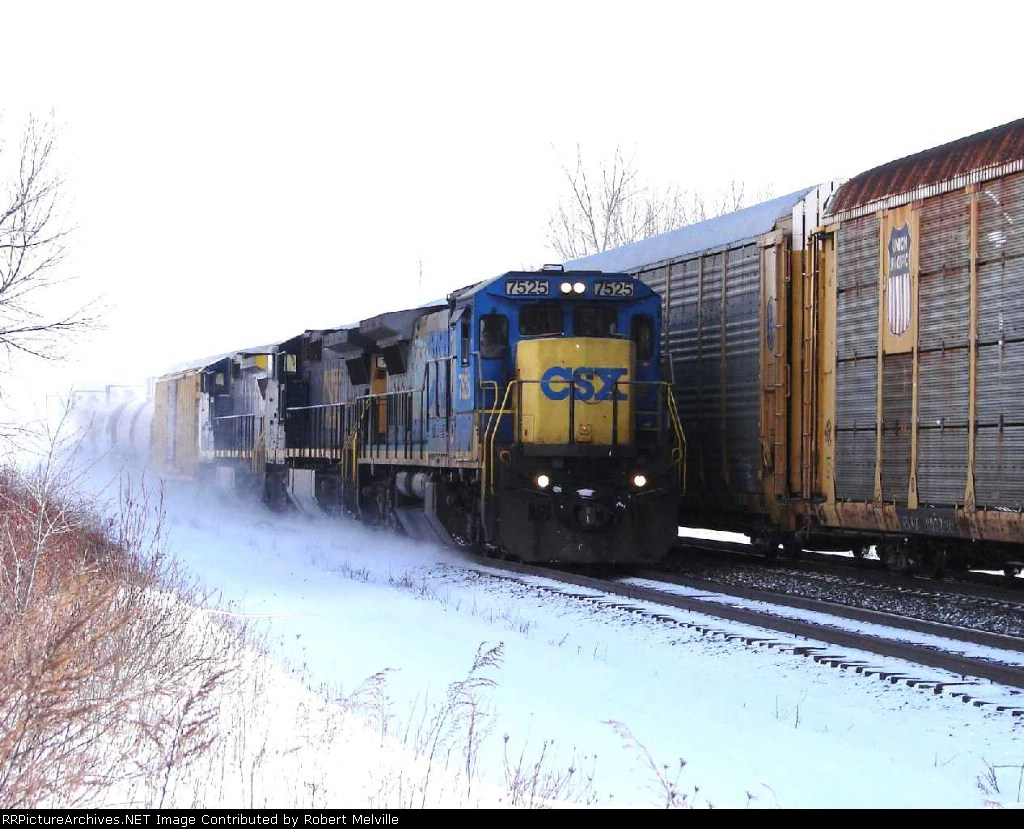 CSX 7525 passes stalled autoracks near Savage Rd