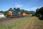 CSX Q264 drifts downhill with BNSF trailing