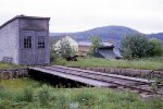 Maine Central wooden wedge plow and one stall engine house at Beecher Falls, Vt
