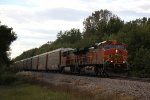 BNSF 4940 Heads a EB rack train though the Mississippi river bottoms.