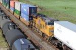 UP 7502 Works mid train dpu.