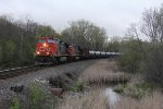 IC 2714 & CN 2153 cruise south on the Waukesha Sub with the crude oil loads of U738
