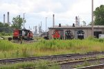 Privately owned switchers and a CN SD60 sit outside Lambton Diesel