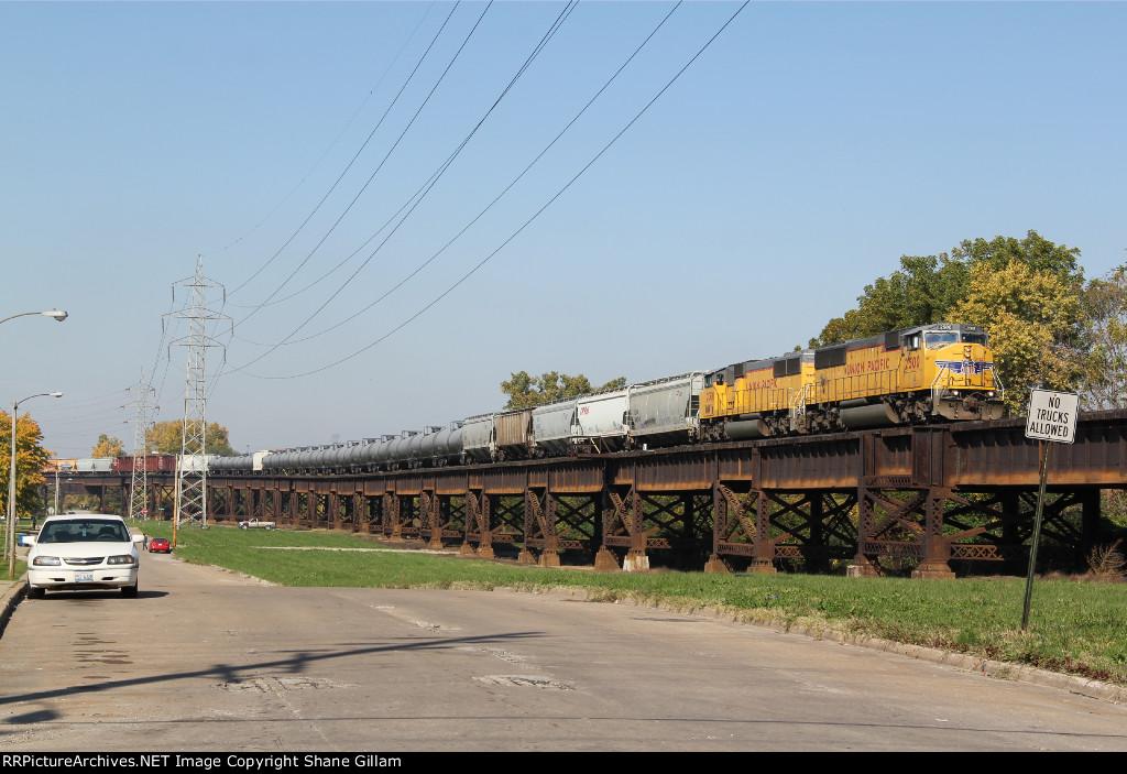 2 Up 60M's lead a transfer train East into East Saint louis IL.