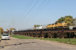 2 Up 60M's lead a transfer train East into East Saint louis IL.