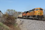 BNSF 8879 Leads a SB coal load on clear blue sky day.