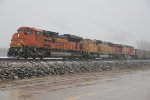 BNSF 9237 Heads a empty coal into a little snow.