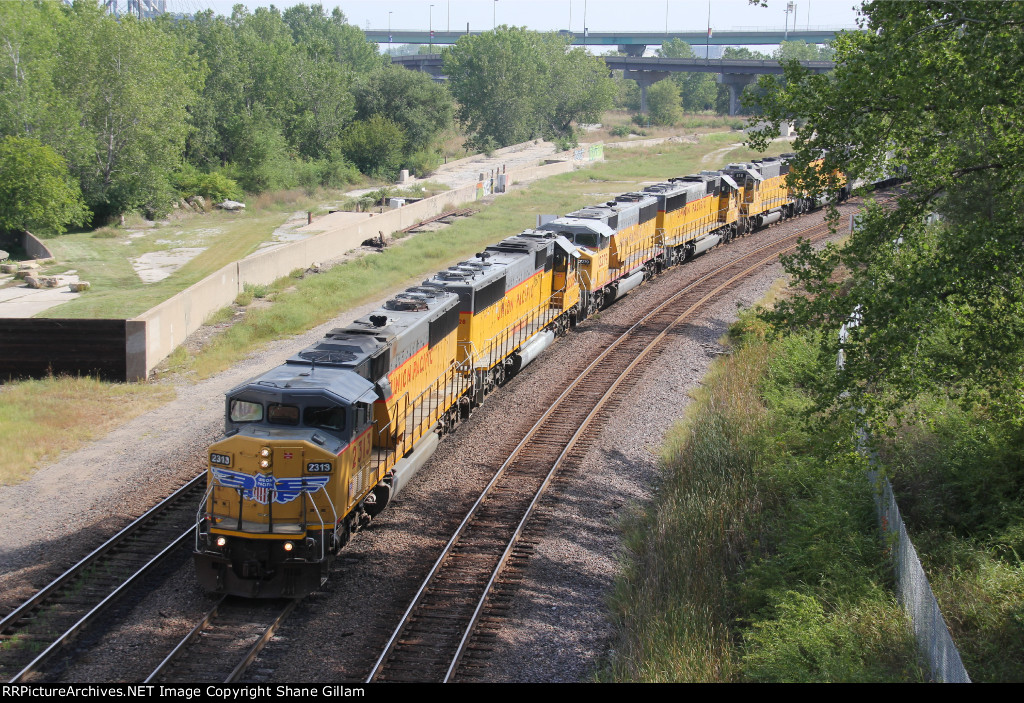 UP 2313 Leads 5 other EMD's on a Wb Local job.