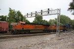 BNSF 7504 Leads a WB stack train under a huge signal bridge.