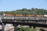 BNSF 8117 New gevo leading a hot pig train over the flyover.