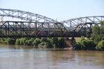 BNSF 6006 Heads a coal load over the Hannibal Bridge.