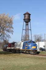 A pair of Old EMD's on the Tillsonburg Job pass the old water tower.