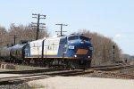 "OSR's matching pair of EX-Rail Link FP9u's cross the CN at ""Carew"""