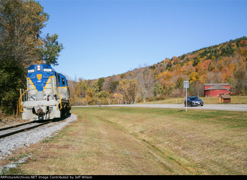 5017 rolls by the historic Round Barn