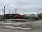 CN 5379 and a tank car
