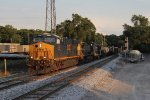 CSX 3104 leads Q335 west through the day's last spots of sunshine at Seymour