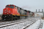 Westbound passes through the snow flurries