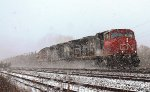 Eastbound mixed freight fighting it's way through the snow