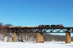 Train 148 crosses the frozen Grand River