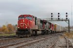 A long Westbound mixed freight with autoracks  tank cars and boxcars