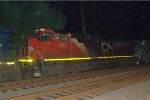 CN SD70M-2 8887 trails on Q702-19