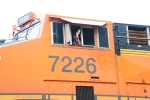Crewman gives a wave from BNSF 7226