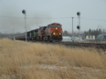 BNSF 1104 Dash 9 leading grain cars