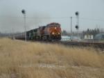 BNSF 1104 Dash 9 leading grain cars