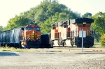 """The conductor of BNSF 4828 (nb) on the ground giving BNSF 6746 (sb) the eyeball. """"Good to the marker"""""""