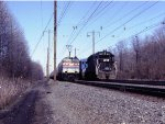 Amtrak 959 South, passing a stopped Conrail freight
