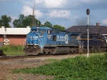 A Conrail Big Blue leads and NS train over the CSX Diamond in Opelika.