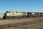 "NS ""naked"" 9838 Leads NS grain train at 32nd st"