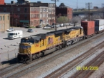 CSX train R106 passes downtown with UP power