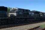 NS SD70ACe 1022 trails on 21M