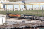 BNSF 9837 works dpu on a SB coal load in kansas city.